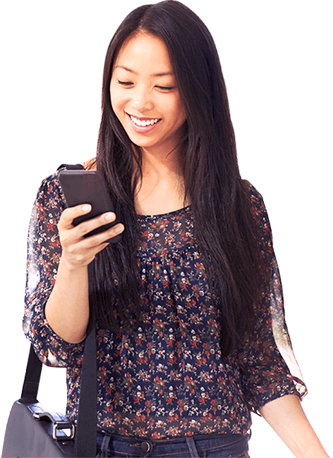 Female jobseeker looking at phone and smiling.