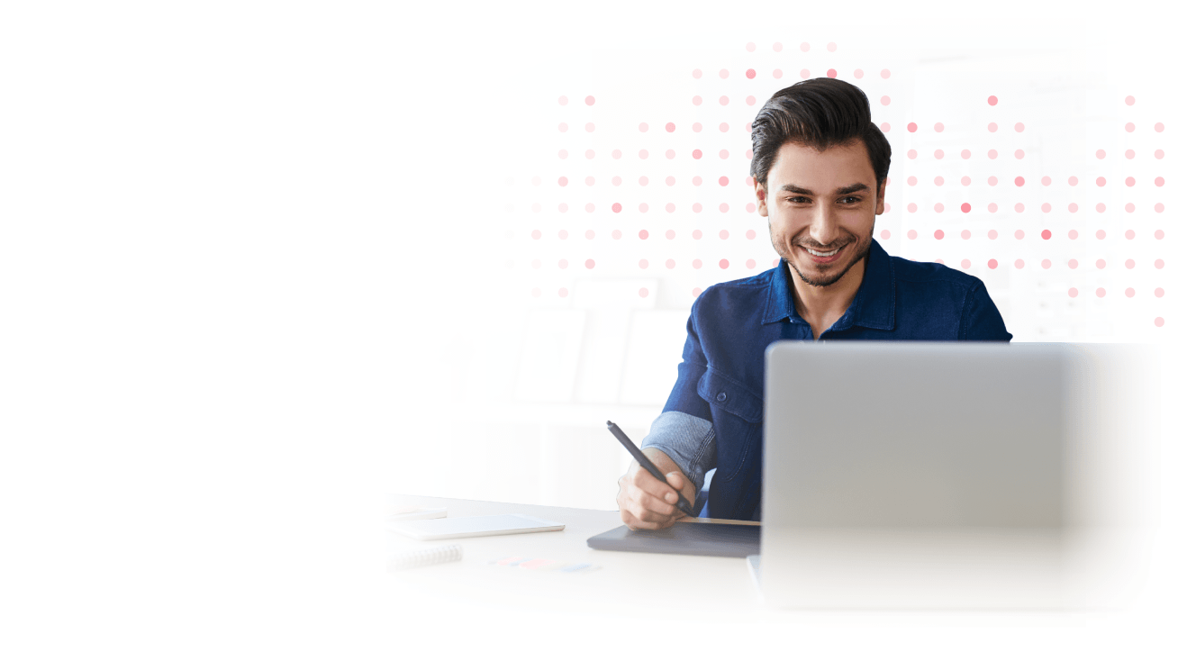 Male marketer smiling in front of computer.