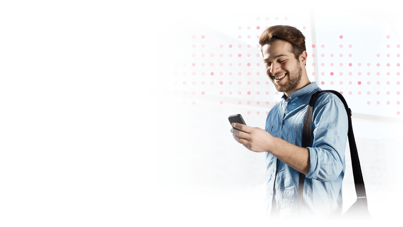 Male marketer smiling and looking at cell phone.
